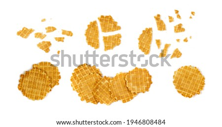 Round waffle isolated. Thin waffled cookie and broken golden belgian waffles, wafer breakfast on white background Сток-фото ©