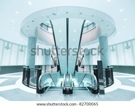 Round walkway and escalator in modern building