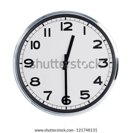 Round wall clock shows half past twelve