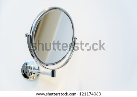 Round wall mirror for the bath. Photo Close-up
