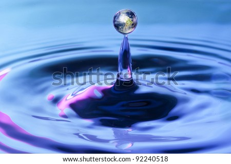 Round water drop of water with earth inside. Concept for environmental awareness. Go Green. Save the earth.