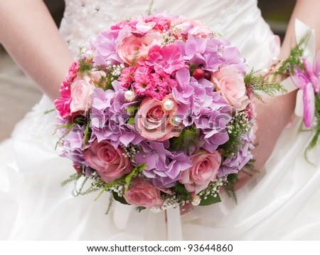 round wedding bouquet of pink flowers