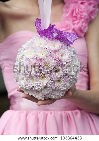 Round wedding bouquet with pink flowers