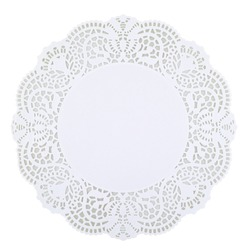 Round white doily isolated on white background, copy space. Clipping path