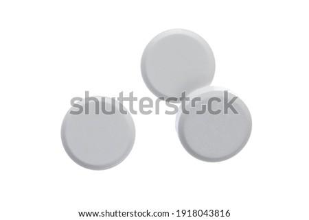 Round white pills isolated On white background Zdjęcia stock ©