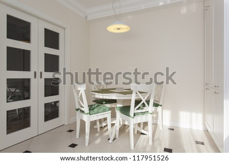 Round white table in bright and modern kitchen