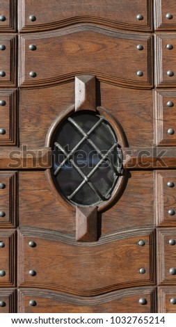 Round Window In A Wooden Door #1032765214