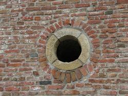 Round window in brick wall