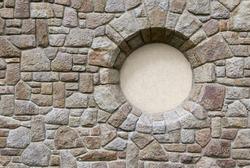 Round window on a stone wall