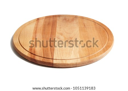 Round wooden beech cutting board isolated on white background
