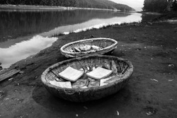 Round wooden boats for travel at Echo Point, Munnar, Kerala, India
