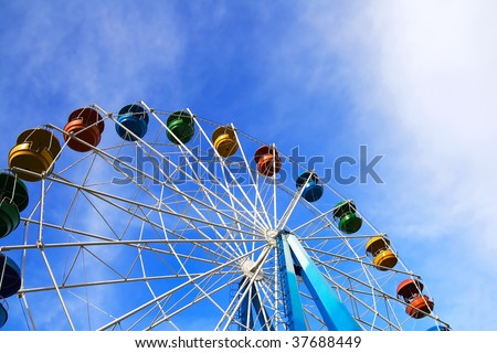 Roundabout - a big color wheel against the background of the blue cloudy sky