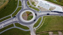 Roundabout photographed from above. Ensuring a good flow of traffic. Traffic circle in Europe for infrastruture of asphalt construction.