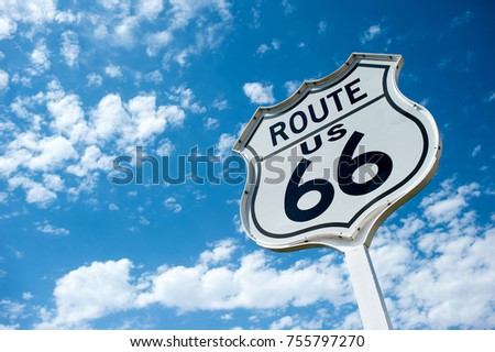 Route 66 angaist blue sky with white puffy clouds on a sunny day #755797270