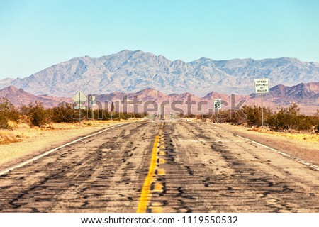 Route 66 crossing the Mojave Desert (near Amboy), California, United States . The road is under repairs.