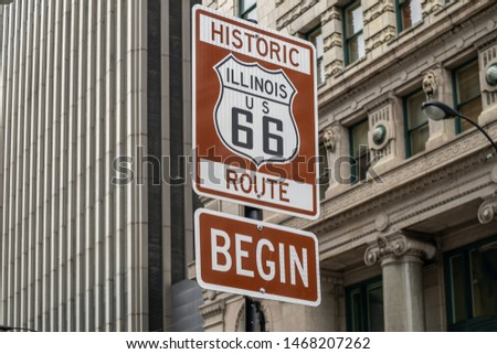 Route 66 Illinois Begin road sign at Chicago city downtown. Buildings facade background. Route 66, mother road, the classic historic roadtrip in USA #1468207262