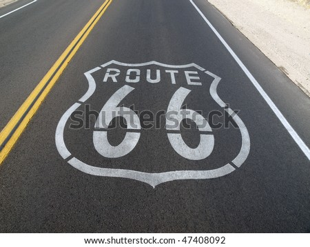 Route 66 sign painted onto the road pavement.
