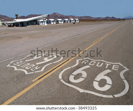Route 66 sign with googie motel background in California's Mojave Desert.