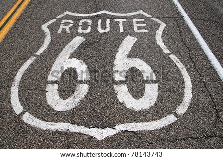 route 66 stenciled on the pavement in white paint