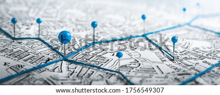 Routes with blue pins on a city map. Concept on the  adventure, discovery, navigation, communication, logistics, geography, transport and travel topics.