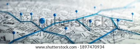Routes with blue pins on a city map. Concept on the  adventure, discovery, navigation, communication, logistics, geography, transport and travel topics. Stockfoto ©