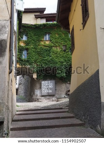 Rovereto, Italy - July 7, 2018. The steep road leads to the Italian War History Museum,  the sign warns of the presence of the museum. #1154902507