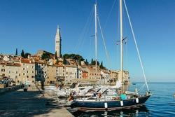 Rovinj,Istria,Croatia.View of the town situated on the coast of Adriatic Sea.Popular tourist resort and fishing port.Old town at sunrise with cobblestone streets, colorful houses and fishing boats