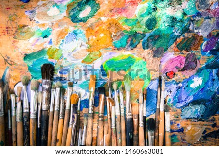 Row artists of Paintbrushes with different sizes lying on dirty artistic palette with free space on top ,background for creative art design (workspace), close, horizontal image #1460663081