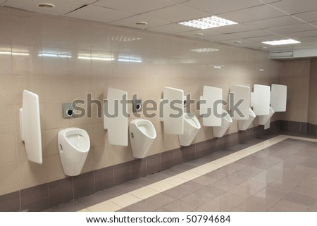 Row automatic urinals in a modern toilet