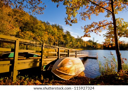Row boat against wood dock in golden afternoon light