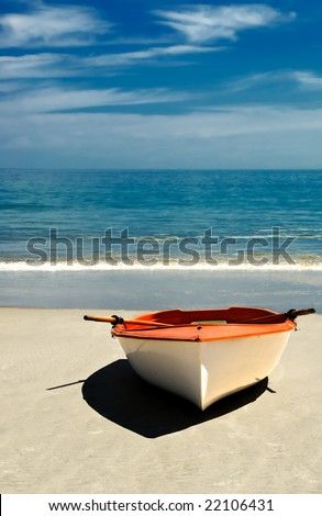 Row boat on the beach of an island paradise ready for a journey.
