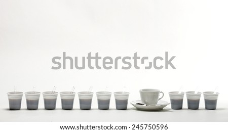 Row cups of coffee, white background