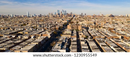 Row houses are lined up and attached to each other street by street all the way to downtown Philadelphia #1230955549