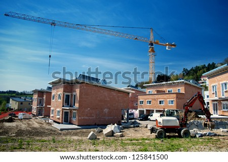 Row Houses under Construction with Crane