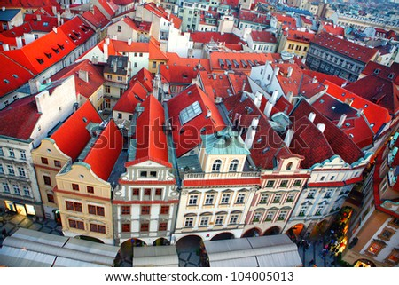 Row houses with traditional red roofs in Prague Old Town Square in the Czech Republic