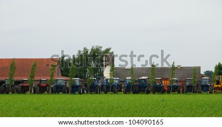 Row of agriculture tractor machines