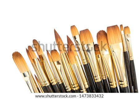 row of artist paint brushes closeup on white background, paintbrushes for wallpaper. #1473833432