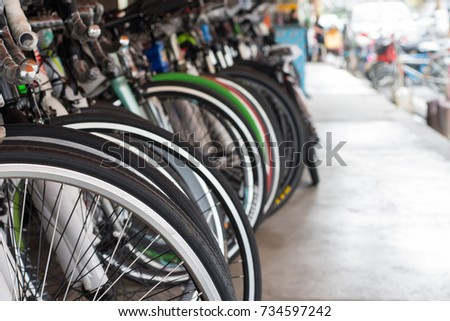 Row of bicycle in bike shop, close up bicycle wheel #734597242