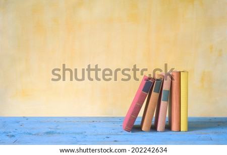 row of books grungy background free copy space