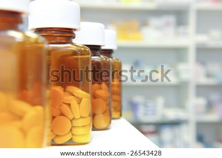 row of bottles and pills on a chemists counter
