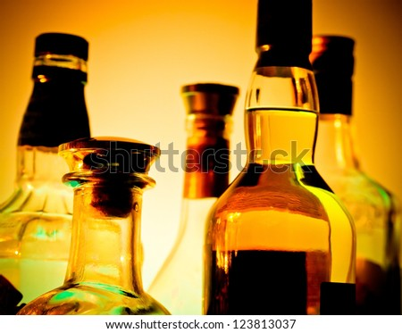 Row of bottles at a bar  over yellow background