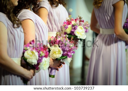 Row of bridesmaids with flowers