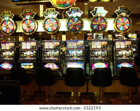 row of brightly lite slot machines