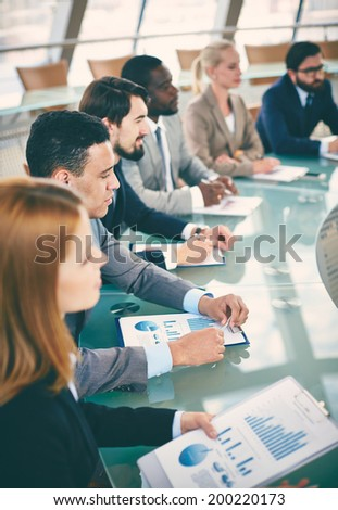 Row of business people listening to presentation at seminar - Shutterstock ID 200220173