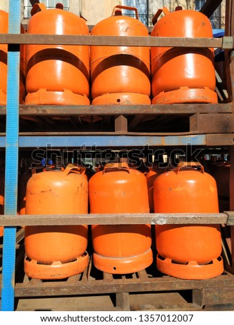 row of butane cylinders, prepared for transport #1357012007