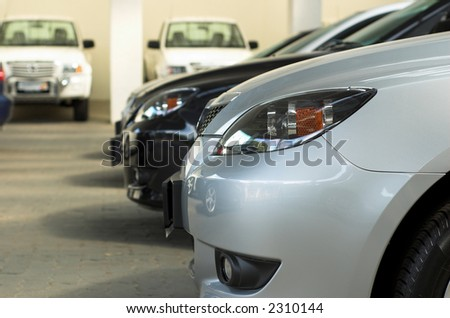 Row of cars for sale in motor dealership