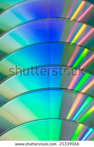 row of CDs with colorful reflection