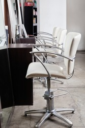 Row of chairs in hair salon