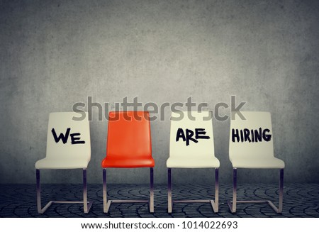 Row of chairs saying We are hiring offering vacant places.
