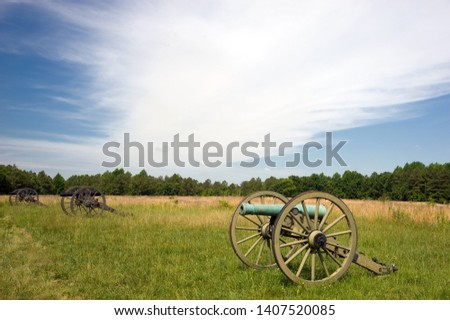 Row of civil war cannons on the battlefield #1407520085